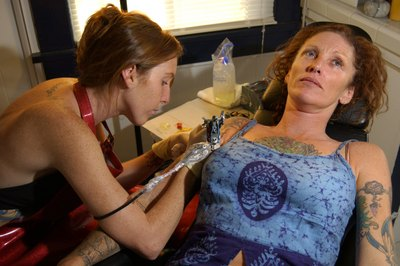 Professional piercers, who sometimes do tattoos, earn more in Washington, D.C.