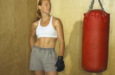 Several types of workouts with a punching bag will help build your abdominal muscles.