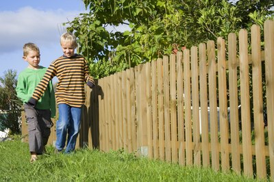 You can build a low-cost fence from wood pallets.
