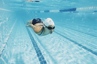 Swim caps reduce friction, helping to increase speed.