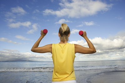 Dumbbell exercises can help build strength and tone muscles needed for swimming.