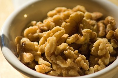 Regularly eating small amounts of walnuts may help you maintain your weight.