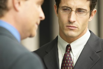 Insecure colleagues belittle, tattle and stir up trouble in an office.