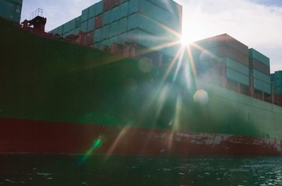 An import-export manager plans shipping and storage of goods and materials.