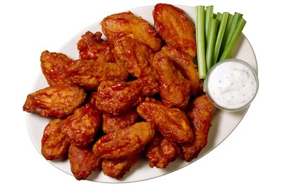 Hot wings are often served with blue cheese dressing for dipping.
