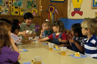 Some daycare staffers provide snacks and meals to children.
