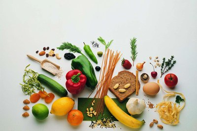 Snacks like fruits, grains and vegetables are solid pre-workout foods for swimmers.