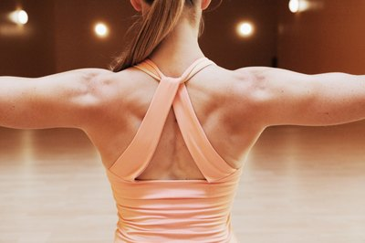 Tone your upper back with resistance bands.