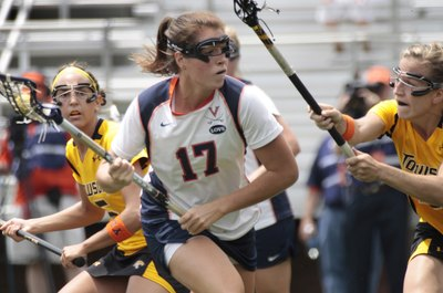Caroline McTierman, center, of the Virginia Cavaliers, battles two Towson Tigers.