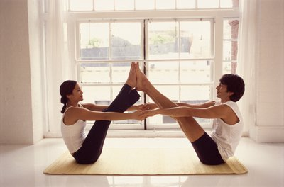Build trust while having fun in couples yoga.
