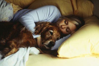 Cuddling with your dog can help relax you for sleep.