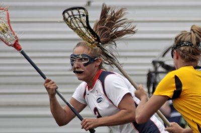 Towson's Katie Cloud, right, keeps her stick high while defending an attacker.