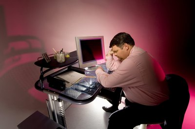 Slouching at your desk can cause back and neck pain.