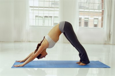Specific yoga poses can help tone your belly.