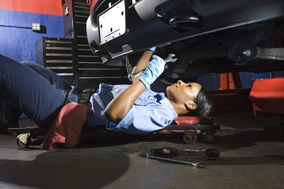 Diesel mechanics may have to maintain awkward positions to make repairs.