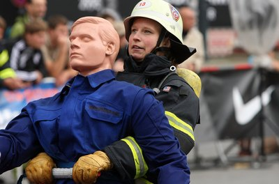 Female firefighters practice and train alongside the men.
