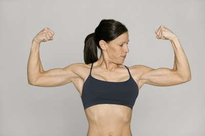 The triceps hang below your biceps when you flex your arms.
