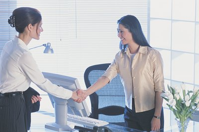 Making eye contact and acknowledging colleagues are two ways to show good manners at work.