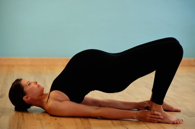 Practice yoga to tone your legs, arms and core.