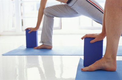 Using a yoga block can help you more easily reach the ground.