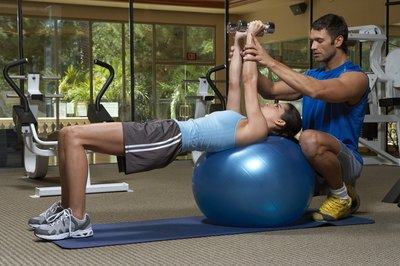Beginners can seek a trainer's guidance for performing dumbbell presses.
