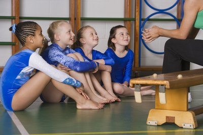 Good coaching will help improve a gymnast's front tuck vault.