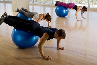 Body-weight training on a stability ball works your abs and glutes.