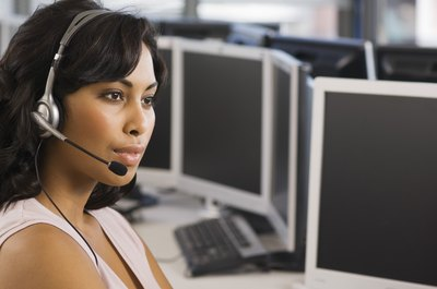 Service desk operators help computer users with problems.