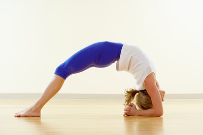 Two-Legged Inverted Stick pose stretches the spine and lower back.