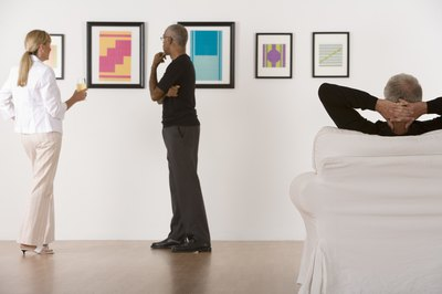 Curators often scout new artists' work for future exhibitions.