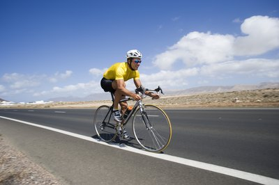 Follow proper form to tone legs while cycling.