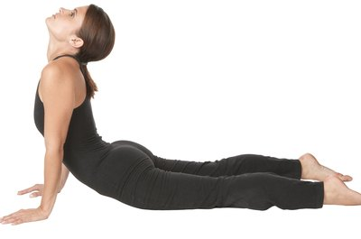 Yoga helps strengthen the spine and stretch the lower back.