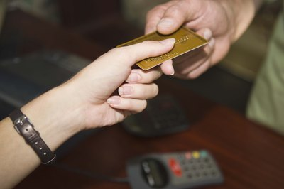 Consumers and merchants benefit from the use of credit cards.