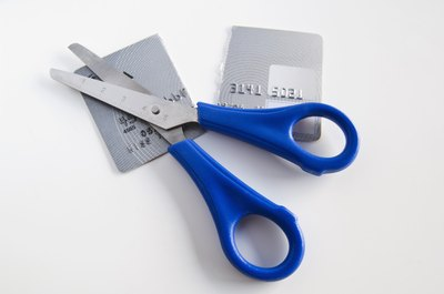 Cutting up your credit cards does not remove them from your credit report.