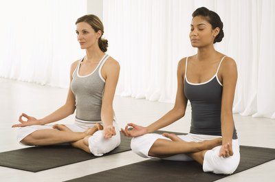 The Lotus pose is a starting position for the Seated Yoga Mudra pose.
