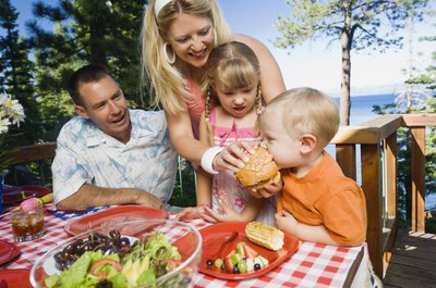 Eat meals with your infant and include him at the dinner table.