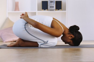 A variation of Child's pose is a relaxing moment in a yoga practice.