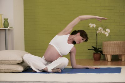 Stretching can reduce pregnancy aches, making you more comfortable.