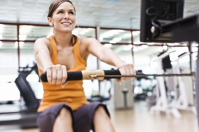 Using a stationary rowing machine gives you a total-body workout that includes cardio and strength training.