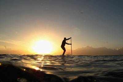 The paddling motion of SUP works your abs.