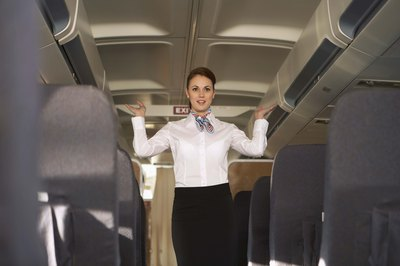 Flight attendants ensure all overhead bins are closed before flights depart.