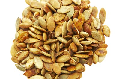 Pumpkin seeds contain trace amounts of vitamins that contribute to overall health.