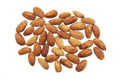One ounce is the standard serving size for almonds.