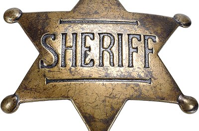 The badge may vary, but sheriffs share many duties across the nation.