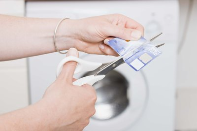 Cut up credit cards to keep from using open lines of credit.