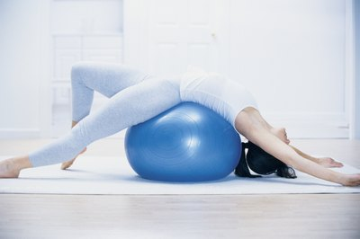 Include exercise ball stretches to target your stomach muscles.