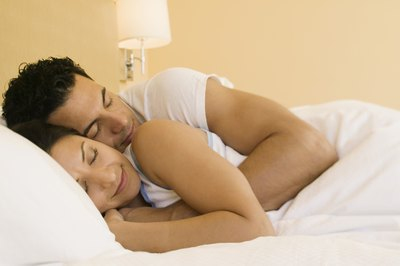 Few couples actually sleep tightly entwined.