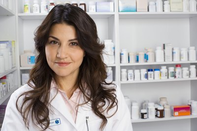 A pharmacist not only fills medical prescriptions for patients but also consults with physicians on treatment.