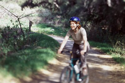 Hit the trails or ride through the neighborhood to shed excess weight.