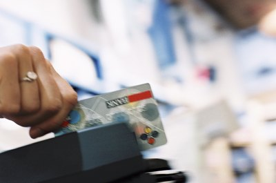 Your debit card won't have a positive effect on your credit score.